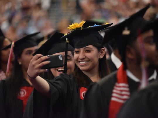 A students takes a selfie at The Montclair State University