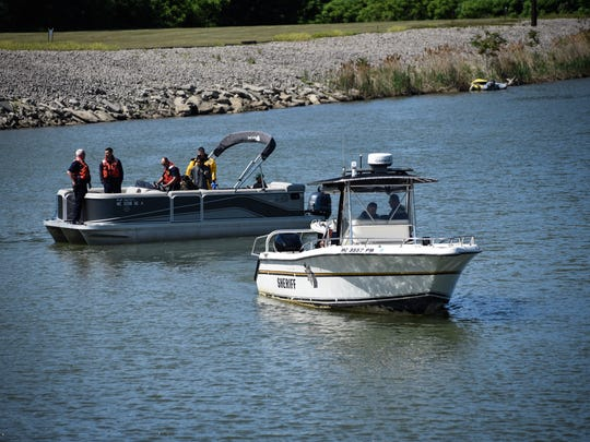 First responders search for two people missing in the Black River Wednesday, June 6, 2018.