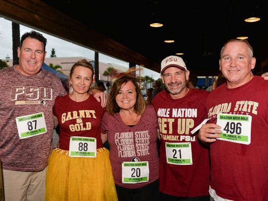 Treasure Coast Seminole Club's Kevin and Terry Murphy, Kim and Ray Coombs and Chris Berkeley.