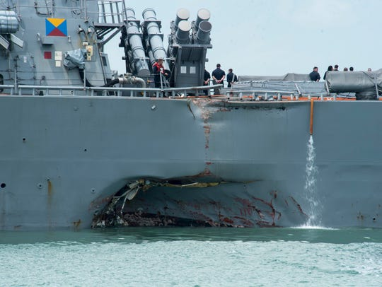 Damage to the port side is visible as the guided-missile