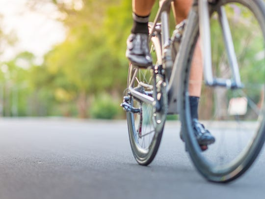 Cycling doesn't burn as many calories as running, but it's easier on your body.