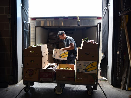 Table to Table picks up surplus food at ShopRite in Wallington to deliver it to First Seventh Day Adventist Church Food Pantry in Montclair. Bruno Facundo, a driver with Table to Table, loads food onto the truck on Thursday June 21, 2018.