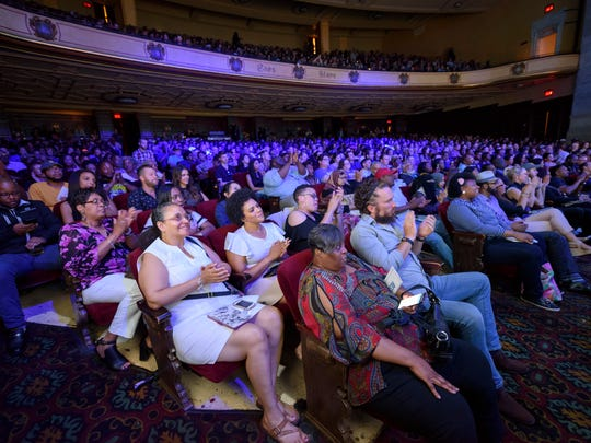 "A full theater watches the Quicken Loans Detroit Demo Day at the Detroit Music Hall, in Detroit, June 22, 2018.  Seven winning companies will receive a total of $1.2 million in funding from Quicken Loans during a ""shark tank"" style competition."