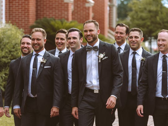 Groom Butch Roussel and his 15 groomsmen make their way to St. John Cathedral