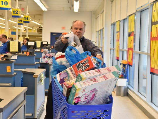 Regular customer Randy Swickle of Ridgewood shops during the final Saturday at Toys R Us store in Paramus, NJ.