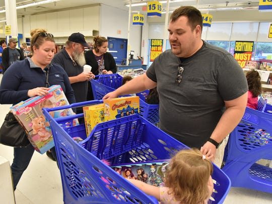 Brian Magrogan and his wife Grace of Hillsdale, NJ shop for toys for their 3 year old daughter Allyson during the final Saturday at Toys R Us store in Paramus, NJ.