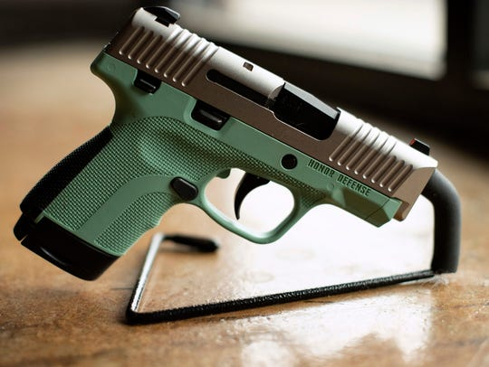 In this April 25, 2018 photo, a .9mm handgun produced