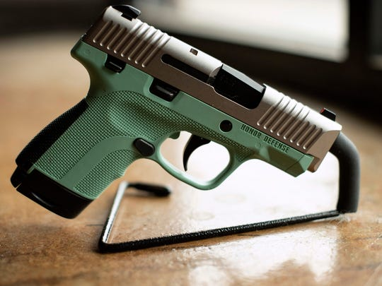 In this April 25, 2018 photo, a .9mm handgun produced by Honor Defense, a gunmaker in Gainesville, Ga., is displayed. In the wake of high-profile mass shootings, corporate America has been taking a stand against the firearms industry amid a lack of action by lawmakers on gun control. Payment processing firms are limiting transactions, Bank of America stopped providing financing to companies that make AR-style guns, and retailers like Walmart and Dick's Sporting Goods imposed age restrictions on gun purchases.