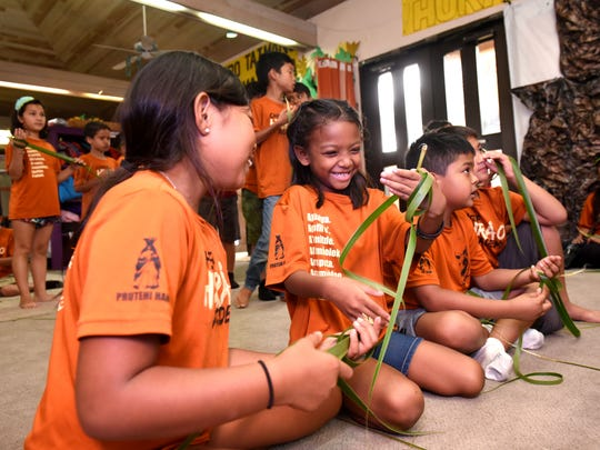 Students, attending the Tiempon Somnak Summer Program, try their hands at weaving a katupat, or rice pouch, from a coconut leaf at the Chief Huråo Academy in Hagåtña on Tuesday, June 26, 2018. The summer program aims to enrich a child's experience with the Chamoru language and culture through lessons of the Chamoru language, cultural dancing, singing, chanting, weaving, cooking, historical field trips and more.