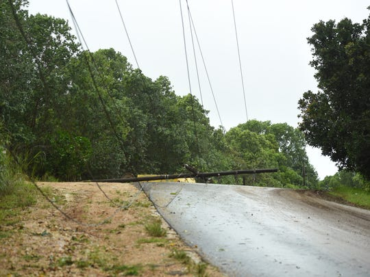 In this July 2018 file photo, downed power lines and fallen utility poles gave reason for emergency personnel to close a section of Route 17, also known as Cross Island Road.