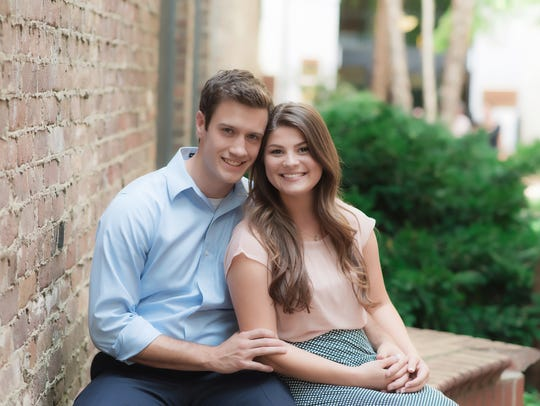 Bobby and Tori (Bates) Smith pose in a photo shoot