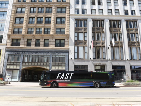 A SMART FAST bus travels along southbound Woodward Avenue at Grand Circus on Thursday, July 26, 2018. A renewal will be on the August ballot. 