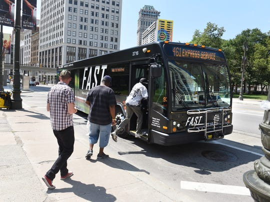 A SMART FAST bus picks up riders along northbound Woodward Avenue at Grand Circus on Thursday, July 26, 2018.