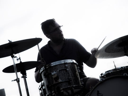 A drummer jams out during a set at the White Rose Bar