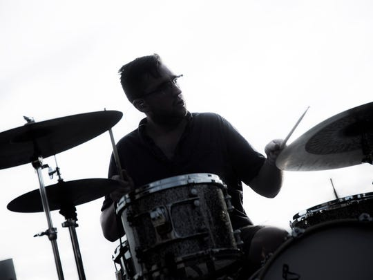 A drummer jams out during a set at the White Rose Bar and Grill during the July First Friday. Musicians of all kinds can be heard playing across downtown York on First Fridays.