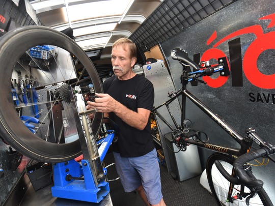 Rob West, master technician for Velofix Detroit, works in the full-service mobile bike shop.