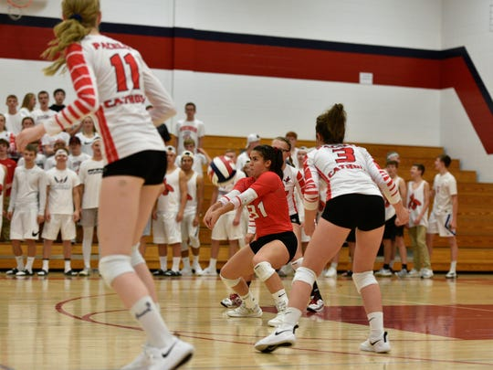 Pacelli junior libero Maddie Hintz bumps the ball to initiate the Cardinals attack in a nonconference dual meet with Marathon at the Student Activities Center on Thursday night.