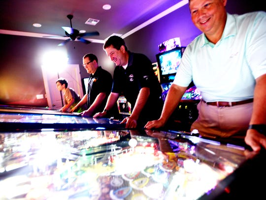 Left to right, Henry Sockrider, Chris Sockrider, Bill Davis and Trey Lankfordare are pinball enthusiasts.
