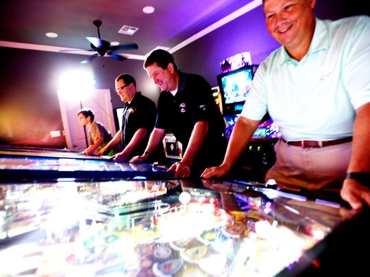 Left to right, Henry Sockrider, Chris Sockrider, Bill Davis and Trey Lankfordare are pinball enthusiasts.