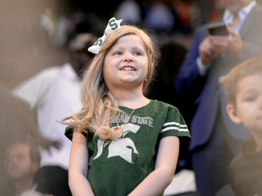 Lacey Holsworth family watch as the Spartans take the