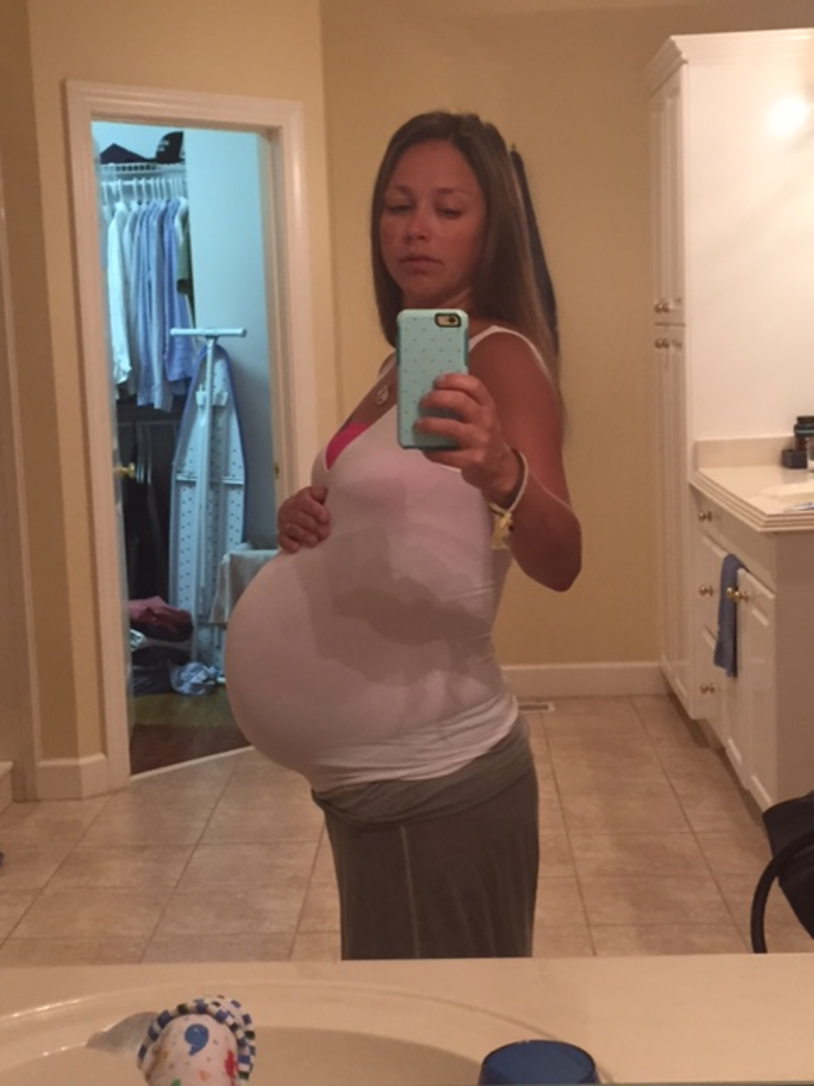 Talia Gates snaps a picture near the end of her pregnancy