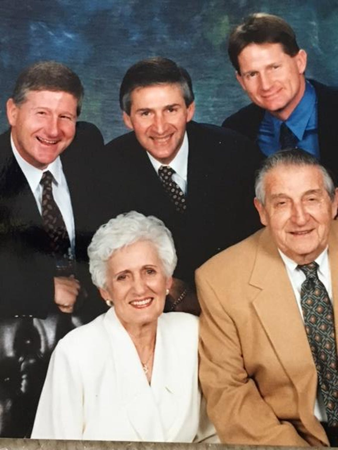 A family portrait of Randy Ball, clockwise from left,