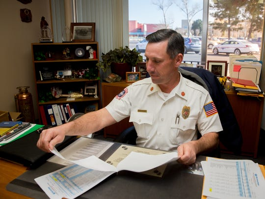 City of Las Cruces Fire Chief Travis Brown works in his office at Fire Station 1 on East Picacho Avenue. Brown, who is in charge of 138 fire department personnel, is retiring in May after 26 years of service.