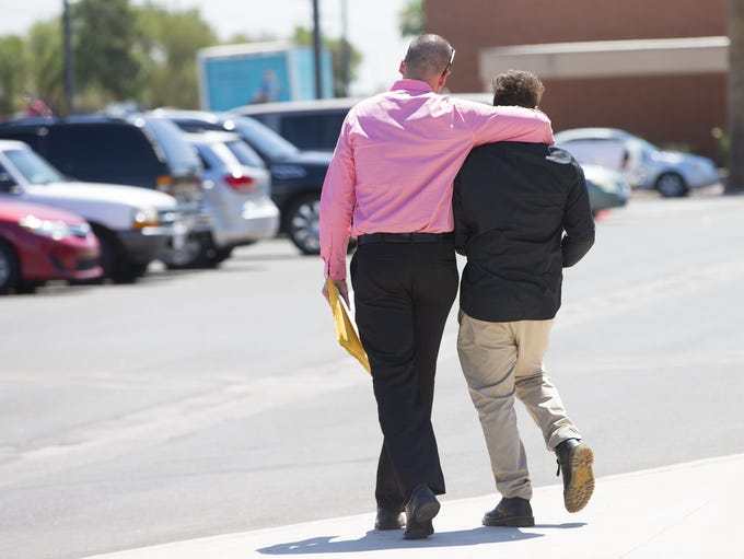 "Nick Dugas, 30, walks with his 14-year-old son, ""Bug,"""