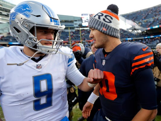 FILE - In this Sunday, Nov. 19, 2017, file photo, Detroit Lions quarterback Matthew Stafford (9) and Chicago Bears quarterback Mitchell Trubisky (10) greet each other after an NFL football game,, in Chicago. The Lions won 27-24. Both coaches will be leaning on their quarterbacks, Matthew Stafford and Mitchell Trubisky, to make all the right moves on Saturday in Detroit. (AP Photo/Charles Rex Arbogast, File)