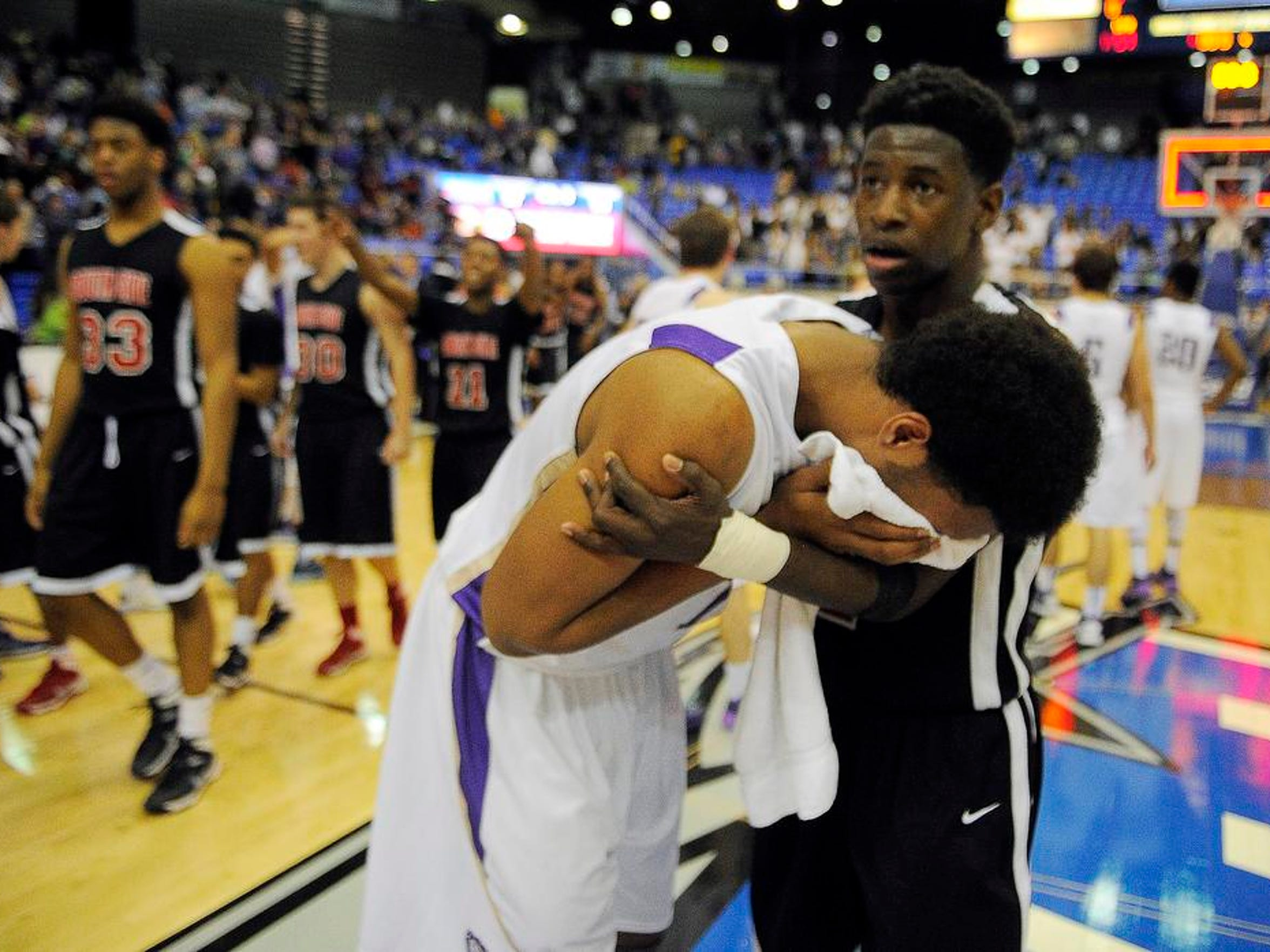 After making the winning shot, South Sides' Jaylen Barford tries to comfort Braxton Blackwell after South Side defeated 59-57 in the boys Class AA basketball semifinals at MTSU on Friday March 14, 2014, in Murfreesboro, TN.