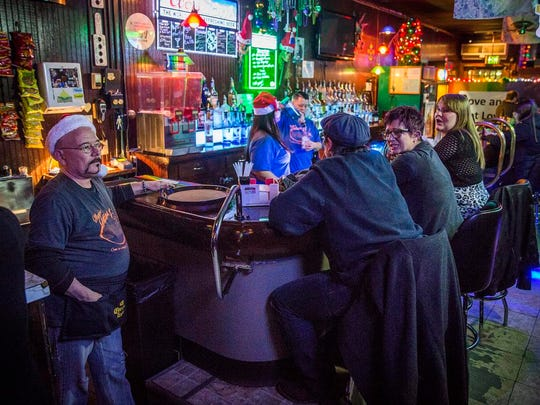 Owner Keith Martz stands at the edge of the bar at