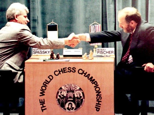 Russian-born chess master Boris Spassky (L) shakes hands with U.S. Bobby Fischer (R) at the beginning of their first match in the Hotel Maestral 02 September, 1992 in Sveti Stefan, Yugoslavia.