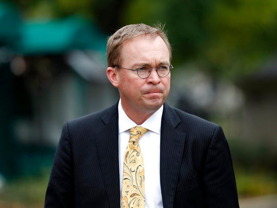 FILE - In this Sept. 13, 2017 file photo, Director of the Office of Management and Budget Mick Mulvaney departs after a television interview at the White House in Washington.  Senior Trump administration officials said Saturday, Nov. 25,  that they expect no trouble when President Donald Trump's pick for temporary director of the Consumer Financial Protection Bureau shows up for work, despite the clash on who should take over.   Trump announced he was picking Mulvaney within a few hours of Richard Cordray's announcement on Friday. (AP Photo/Alex Brandon, File)