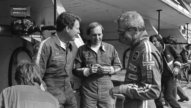 Riding high: The Whittington brothers, Don (left) and Bill, at LeMans in 1979, with Paul Newman.