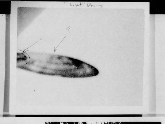 This picture, which supposedly shows a flying saucer, was taken in San Bernardino in 1956. The military has dismissed this picture as a hoax.