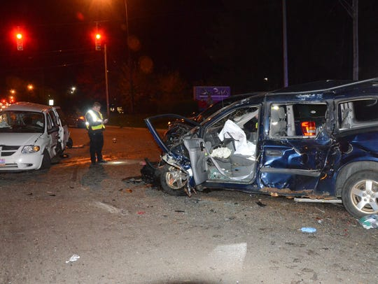 Two of the damaged vehicles following the crash.