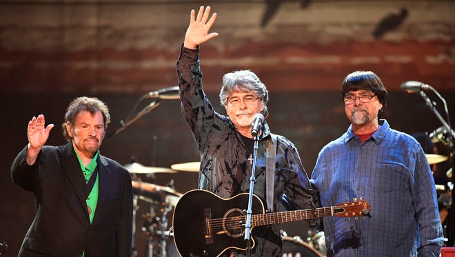 From left, Jeff Cook, Randy Owen and Teddy Gentry of Alabama wave to the crowd at the Merle Haggard tribute concert April 6, 2017, at Bridgestone Arena.