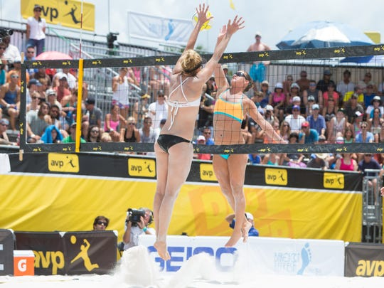Brooke Sweat, right, cuts the ball against April Ross during the final of the AVP St. Petersburg Open on June 1.