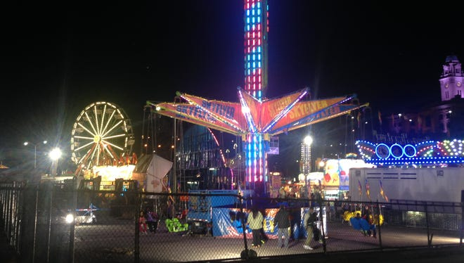 A woman was shot near this carnival at the Chicken Island municipal parking lot in Yonkers on Sunday, April 13, 2014.