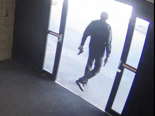 A video still from security camera footage that police said shows Isaiah Currie, 20, leaving the lobby of University of Cincinnati Emergency Psychiatric Services Dec. 20 after shooting at a security guard.