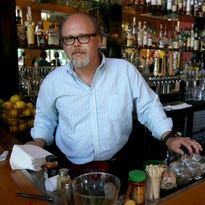 Rob Melton, who has been a bartender for 31 years, poses for a photo at Table FIVE 08.