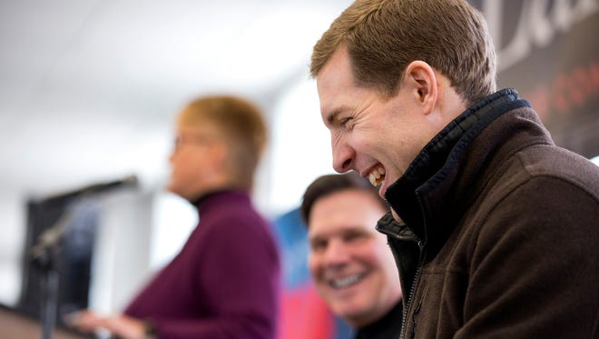 Democratic candidate Conor Lamb laughs during a rally with the United Mine Workers of America, Sunday, March 11, 2018, at the Greene County Fairgrounds in Waynesburg, Pa. Lamb is running against state Rep. Rick Saccone for Pennsylvania's 18th Congressional District in a special election on Tuesday. (Antonella Crescimbeni/Pittsburgh Post-Gazette via AP)