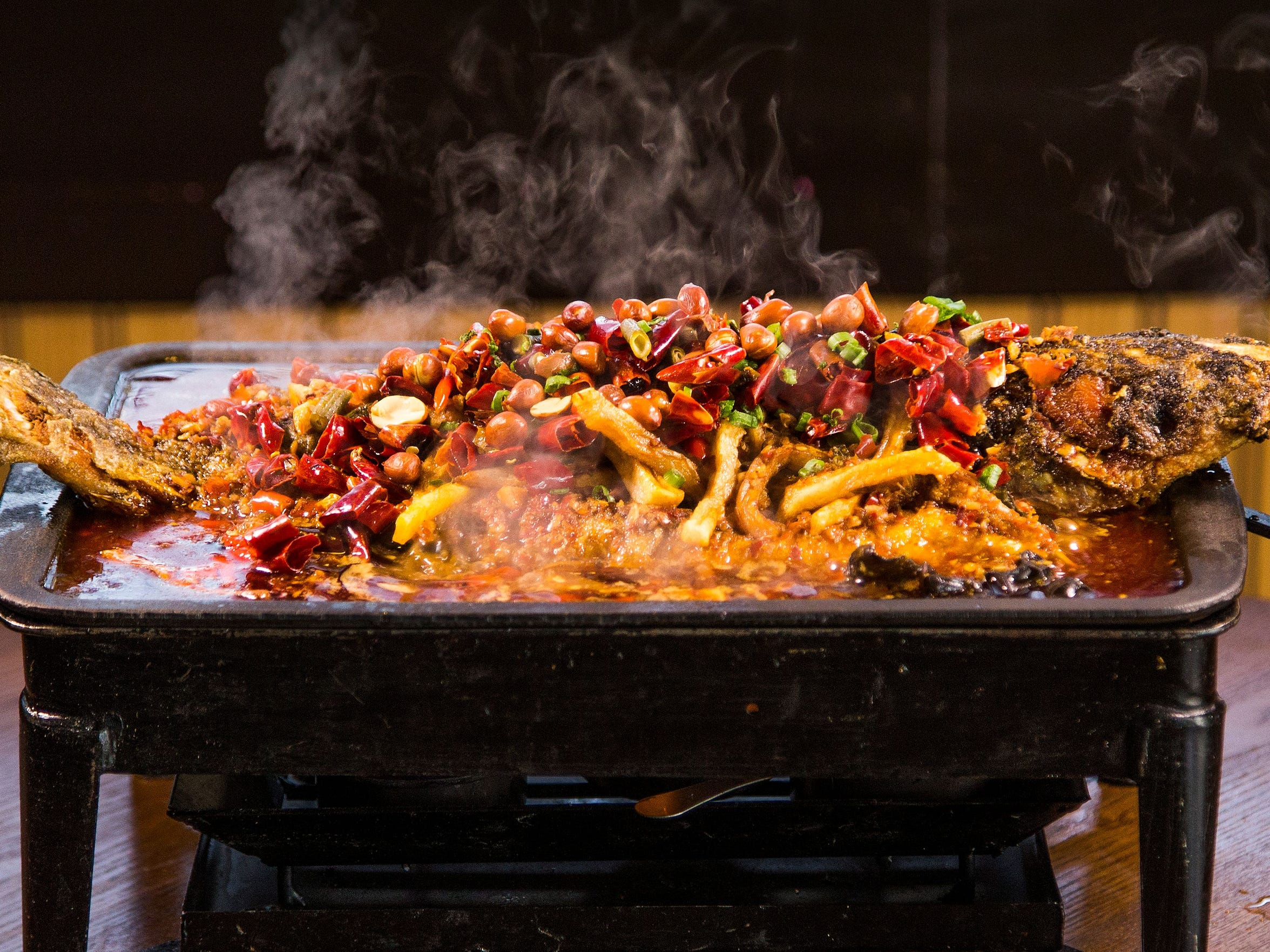 Original Cuisine boasts a lengthy menu of dishes that tweak traditional Sichuan cuisine while maintaining its essential character. Pictured is the barbecue fish.