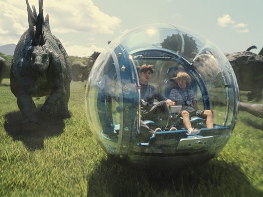 "Nick Robinson (left) and Ty Simpkins in a scene from ""Jurassic World."""