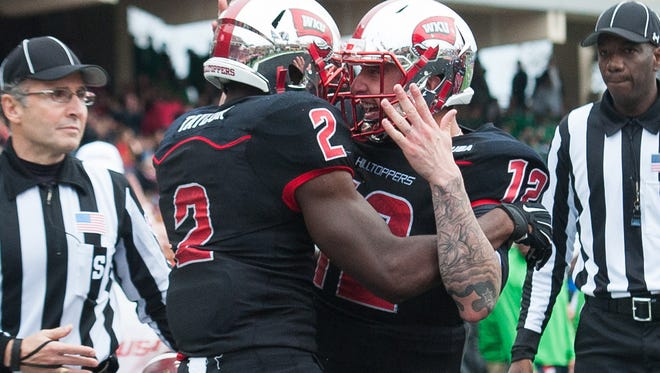 Nov 27, 2015; Bowling Green, KY, USA; Western Kentucky Hilltoppers wide receiver Taywan Taylor (2) celebrates with quarterback Brandon Doughty (12) after scoring a touchdown during the first half against Marshall Thundering Herd at Houchens Industries-L.T. Smith Stadium. Mandatory Credit: Joshua Lindsey-USA TODAY Sports