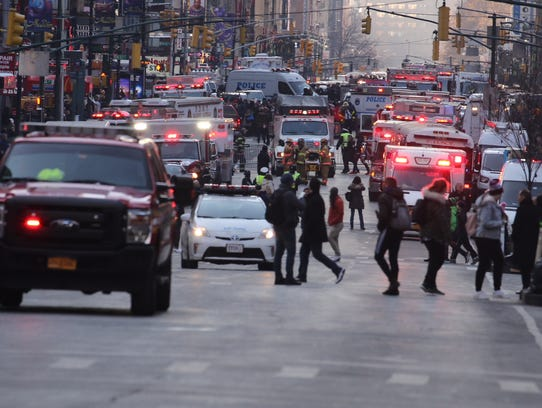 Heavy police and fire presence on Eighth Avenue near the Port Authority bus terminal after Monday's explosion.