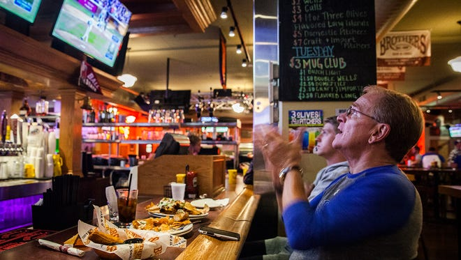 Mayor Dennis Tyler watches the Chicago Cubs play the New York Mets at Brothers Bar and Grill Tuesday, Oct. 20, 2015.