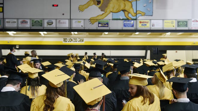 Seniors gather in the gym before Red Lion's graduation on June 3, 2016.