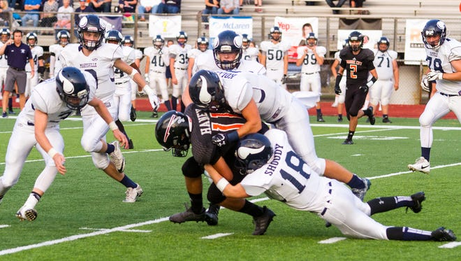Marine City's Dawson Haney is brought down in one of the first plays of their game against Marysville Sept. 15.