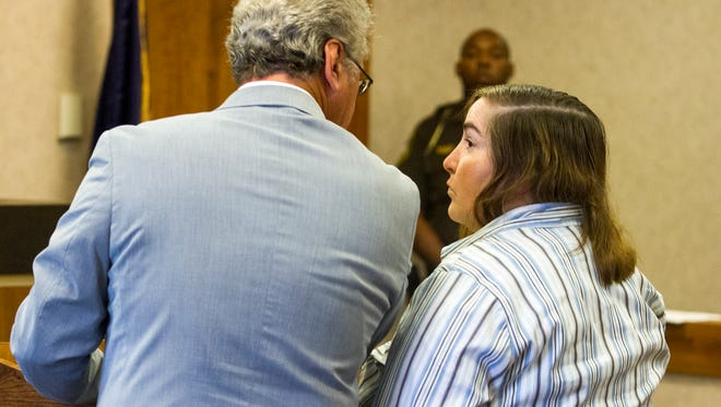 Deidre Mitchell, right, talks with her attorney Robert Carson during her sentencing Sept. 18. Mitchell was sentenced to 120 days in prison for embezzling funds from the Port Huron Township Little League.